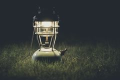 Old lantern On the lawn at night.Vintage colors picture stock photography