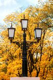 Old lantern in a park in the street Stock Photos