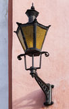 Old Lantern on a pink building wall in Tallinn Stock Images