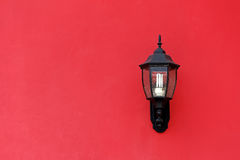Old Lantern on Red Concrete wall Royalty Free Stock Photos
