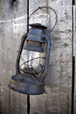 Old Lantern and Saw. Hanging on a shed Royalty Free Stock Images