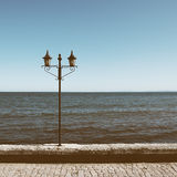 Old lantern on sea background Stock Photos