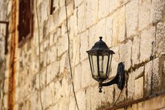Old lantern on a stone wall Royalty Free Stock Image
