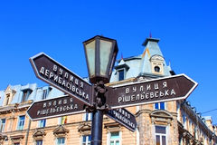 Old lantern with street signs to famous Deribasovskaya street. In downtown Odessa, Ukraine Royalty Free Stock Images