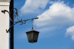 Old lantern on the wall. Stock Photo