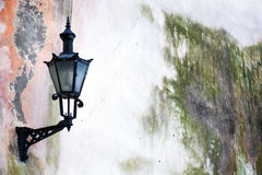Old Lantern on a weathered wall in Tallinn Royalty Free Stock Image