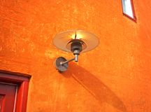 Old lantern in web. Old lamp on orange wall Stock Photography