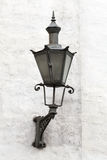 Old Lantern on a white wall in Tallinn Royalty Free Stock Photo
