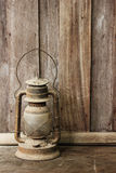 Old lantern on wooden background Royalty Free Stock Images