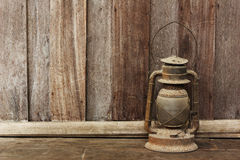 Old lantern on wooden background Stock Photography