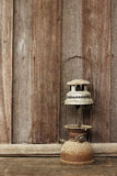 Old lantern on wooden background Royalty Free Stock Photos