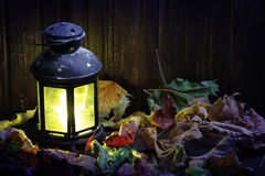 Old lantern on wooden boards Royalty Free Stock Photo