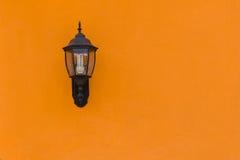 Old Lantern on Yellow Concrete wall , Closeup Stock Photo
