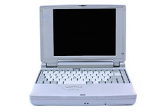 Old laptop. Old, obsolete retro laptop isolated on white Royalty Free Stock Images