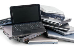 Old laptops. Stack of used laptops for recycle , white background Stock Photo