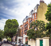 Old large apartment red brick houses in the area  Kensington Olympia, London Royalty Free Stock Images
