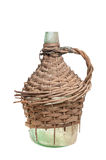 Old large bottles in a wooden braid Royalty Free Stock Photos