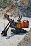 Old large excavator. Old large rusty excavator in a open pit limestone mine Stock Photos