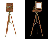 Old large format camera on tripod isolated Royalty Free Stock Photos