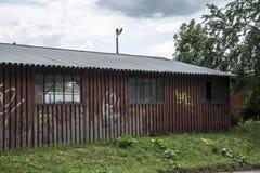 Old large garage Stock Images