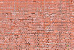 Large brick wall. Old large red brick wall background. Rustic old brick wall texture Royalty Free Stock Photo