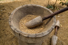 An old large wooden pestle. That separates the beans from their Unlock Royalty Free Stock Photography