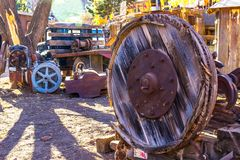 Old Large Wooden Wheel In Salvage Yard. Old Large Wooden Wheel Along With Radiator And Other Wheels In Salvage Yard Stock Images