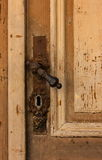 Old latch. And old door Stock Photography