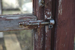 Old latch on the abandoned glass door Stock Photography