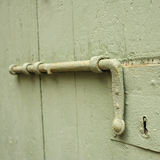 Old latch of a main door Royalty Free Stock Photography