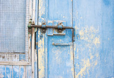 Old latch on a wooden blue door in Tuscany, Italy Stock Photo