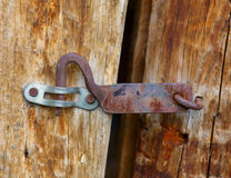 Old latch on a wooden board Stock Image