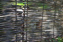 Old lath fence made of willow rods. Natural background. Royalty Free Stock Photography