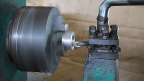 Old Lathe Machine. Is running. The turning tool is cutting object that is held and rotate on the head of lathe machine stock video footage