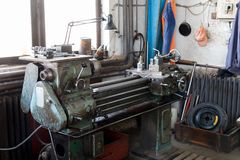 Old lathe machinery with lamp royalty free stock images
