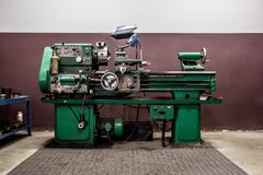 Old lathe in the workshop stock images