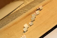 Old Latin book. Opened with bookmark Stock Image