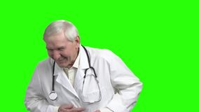 Old laughing doctor, slow-motion. Happy old male doctor, green hroma background stock video footage