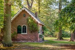 Old Dutch laundry house built in the 2nd half of the 19th centur. Old laundry house in the park on the estate Wallsteyn near the village Achtmaal, municipality stock image