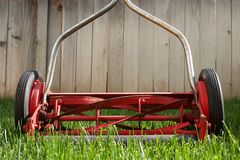 Old lawnmower. Old-fashioned manual reel lawnmower stock photo