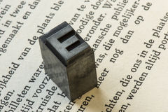 Old lead ink printing type from a book printing company. Historical metal letters from an old printing machine royalty free stock images