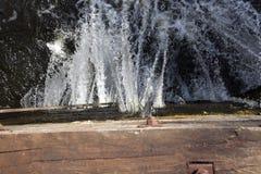 Old leaking dam Stock Image