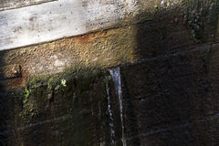Old leaking dam Stock Photo