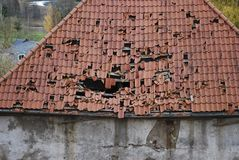 Old leaky red tile roof. Retro architecture Stock Photo
