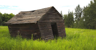 Old leaning farm shed Stock Photo