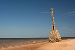 Old Leaning lighthouse. Old lighthouse leaning towards sea Royalty Free Stock Photography