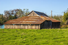 Old Leaning Wood Barn With Rusted Tin Roof Royalty Free Stock Photo