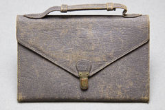 Old leather bag. On grey background Stock Photo