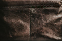 Old leather bag texture with a visible seam. Old brown leather bag texture with a visible seam Stock Photos