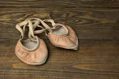 Old leather ballet shoes for gymnastics Royalty Free Stock Photos